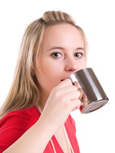 Young Woman Drinking A Hot Cup Of Coff Royalty Free Stock Images