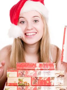 Girl And Christmas Presents. Stock Images