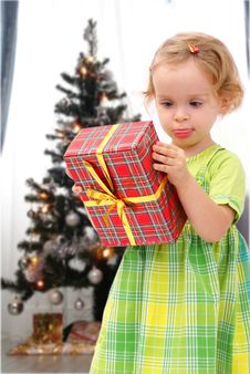 Free Girl With Christmas Present Royalty Free Stock Photos - 3625518