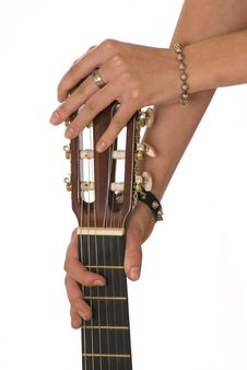 Two Hands And The Brown Guitar Stock Photo