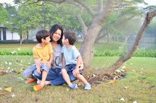 Free Mother And Sons In The Park Royalty Free Stock Image - 36216296