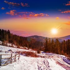 Free Fence By The Road To Snowy Forest In The Mountains Royalty Free Stock Image - 36242756
