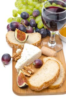 Free Snacks - Cheese, Bread, Figs, Grapes, Nuts And Red Wine Stock Images - 36254934