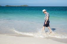 Free Man Walking On A Caribbean Beach 2 Royalty Free Stock Images - 36260279