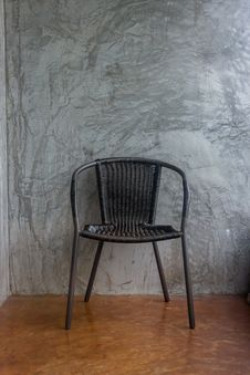 Free Chair On  Wall Concrete Stock Image - 36270091
