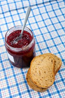 Free Bread And Jar With Raspberry Jam On Blue Tablecloth Royalty Free Stock Photography - 36278057