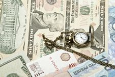 Free Pocket Watch Lie On Dollars Royalty Free Stock Photo - 36279775