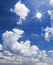 Free Blue Sky With White Clouds And Sun Stock Image - 36272201
