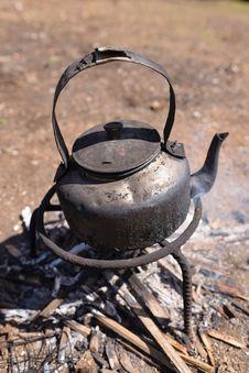 Free Tea Pot On Firewood Royalty Free Stock Photo - 36280645