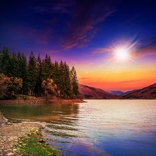 Free Autumn Mountain Lake In Coniferous Forest At Sunset Royalty Free Stock Photo - 36284175