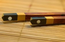 Free Chopstick On A Bamboo Mat Royalty Free Stock Photos - 3631658