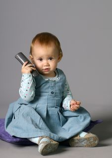 The Child Calling By Phone Royalty Free Stock Photos