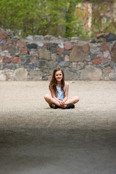 Free Girl Sitting Cross-legged Royalty Free Stock Image - 3639186