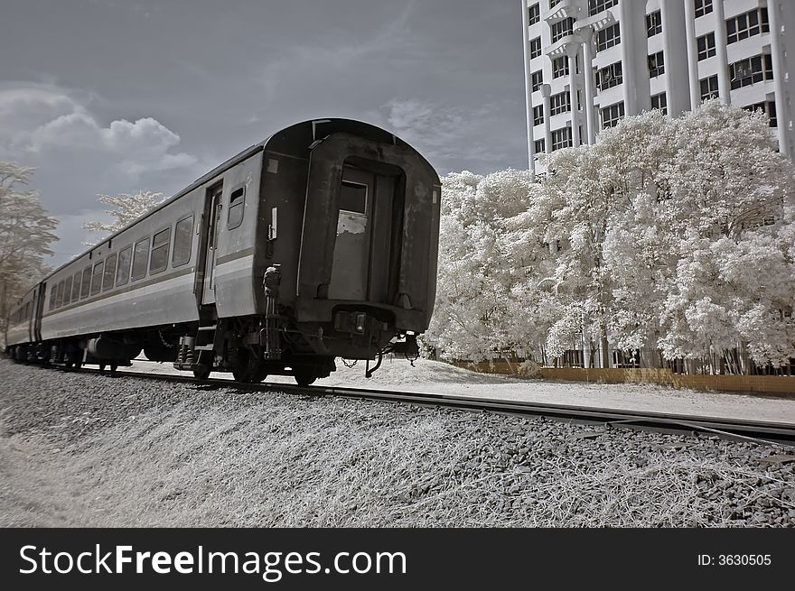 Infrared photo- tree, building and train