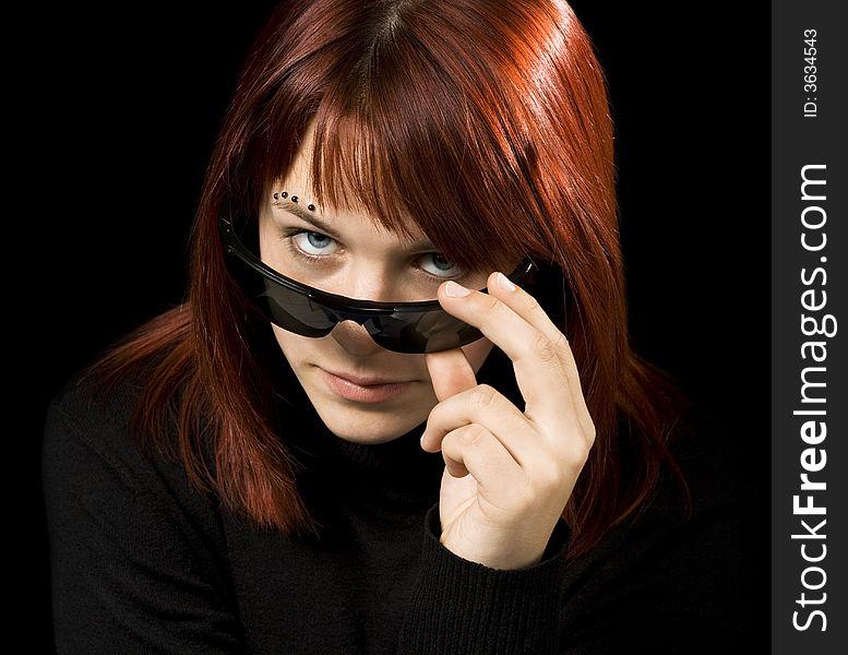 Girl with sunglasses staring at camera