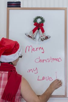 Free Lady In Santa Hat Writing On White Board Stock Photos - 36302833