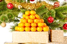 Christmas Tree With Gifts And Mandarines Royalty Free Stock Image
