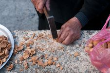 Breaking Almond Nuts. Royalty Free Stock Photos