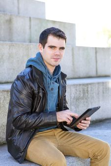 Man With Tablet Computer Looking At The Camera, Outdoor. Royalty Free Stock Image