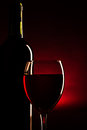 Free Wine Bottle And Glass Silhouette Over Dark Red Royalty Free Stock Photos - 36367688
