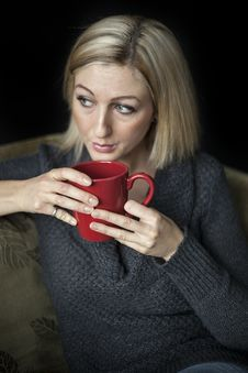 Free Blonde Woman With Beautiful Blue Eyes And Red Coffee Cup. Royalty Free Stock Photography - 36372977
