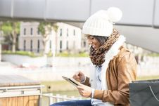 Free Smiling Woman Using Tablet Computer In The Street. Stock Photo - 36379570