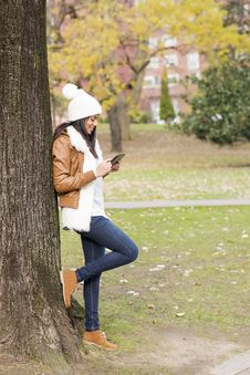 Smiling Woman Using Tablet Computer In The Park. Stock Photos