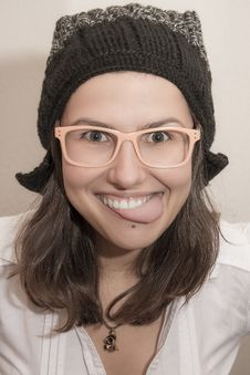 Funny Young Woman Showing Tongue Stock Image