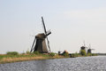 Free Windmills On The Canal Bank. Royalty Free Stock Photo - 36391495