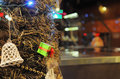 Free Green Gift Box With Lights And Bell On A Christmas Tree Stock Photography - 36394812