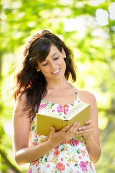 Free Woman Reading And Walking On Park Stock Image - 36393581