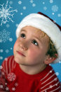 Free Young Boy In A Santa Hat Looking At Snowflakes Stock Photos - 3643083