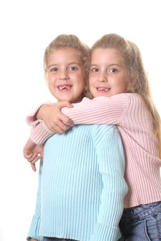 Identical Twin Sisters On White