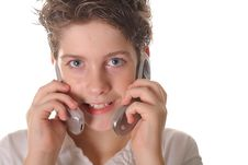 Free Young Boy Talking On Two Cell Phones Stock Images - 3641424