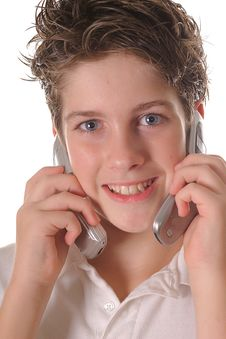 Free Young Boy Talking On Two Cell Phones Upclose Verti Royalty Free Stock Images - 3641429