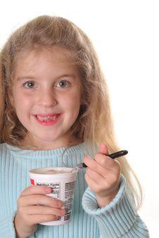 Free Happy Little Girl Eating Yogurt Vertical Stock Photography - 3641492