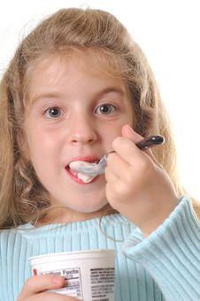 Free Young Girl Eating Yogurt Vertical Stock Photos - 3641523