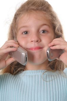 Free Young Girl Talking On Two Cellphones Royalty Free Stock Photos - 3641548