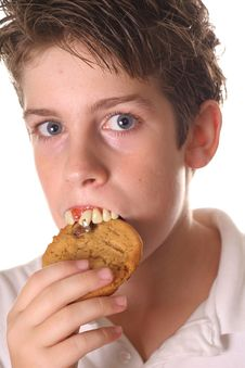 Free Young Boy With Rotten Teeth Eating A Cookie Royalty Free Stock Photography - 3641607