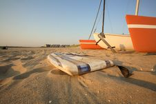 Free Catamaran & Surfboard On Beach Royalty Free Stock Photography - 3641637
