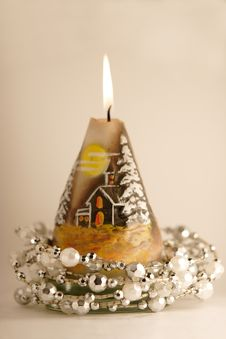 Free Burning Candle With A Silver Garland Royalty Free Stock Images - 3642449