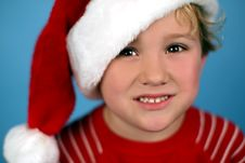 Free A Young Boy Wearing A Santa Hat Royalty Free Stock Photos - 3643078