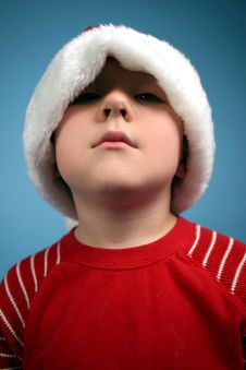 Young Boy In An Oversized Santa Hat Stock Image