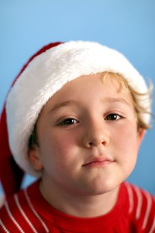 Young Boy Wearing A Santa Hat Stock Photography