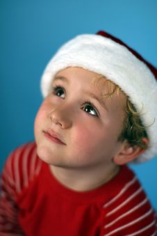 Young Boy In A Santa Hat Stock Image