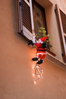 Free Santa Clause Climbing 1 Royalty Free Stock Image - 3644216