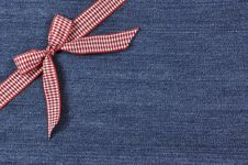 Free Red Ribbon On A Jeans Background Stock Photography - 36409572
