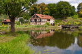 Free Big Family House In Front Of The Lake In The Forest Royalty Free Stock Photos - 36415968