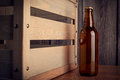 Free A Bottle Of Beer Next To A Wooden Box Stock Photos - 36416343