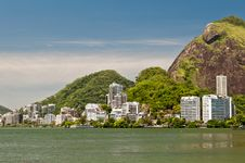 Free Residential Buildings And Mountains Around The Lake Stock Photography - 36415822